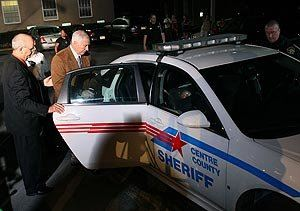 Sandusky getting inside police car